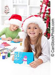 Kids making christmas greeting cards - Children making...