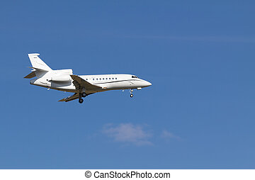 Landing private jet - A private jet without any sign landing...