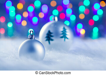 christmas silver baubles witn tree and lights - christmas...