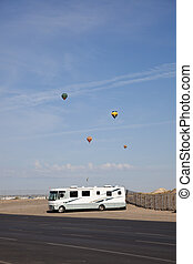 RV parked in Albuquerque Hot air balloons flying above