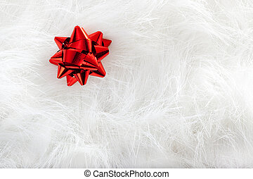Christmas red ribbon look over white fur background