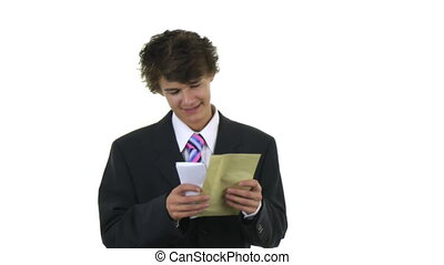 sealing up envelope - A guy sealing up an envelope with a...