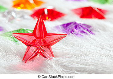 Christmas glass star over winter white fur background