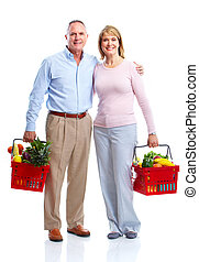 Happy couple with a shopping basket. - Happy senior couple...