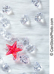 christmas red crystal star on ice cubes and fur