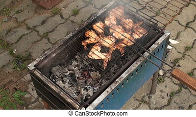 Cooking chicken on the grill