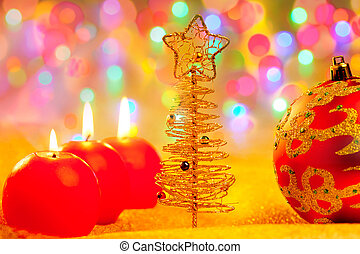 Christmas golden red baubles in blur lights