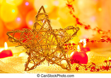 Christmas golden star candles in blurred lights - Christmas...