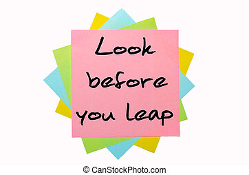 """Proverb """"Look before you leap"""" written on bunch of sticky..."""
