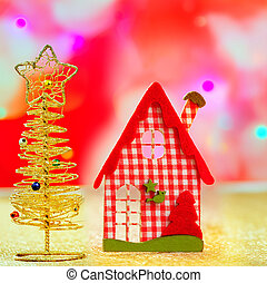 Christmas golden tree and red vichy house in blurred lights