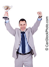 the winner - trophy in the hands of a smiling business man