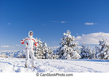 Serious skier on the top of mountain