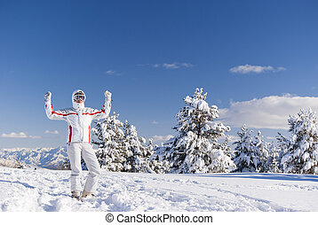 Success skier on the top of mountain