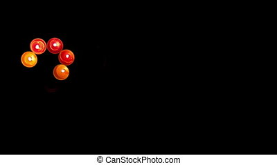 2012 made of colored candles on a black background,...