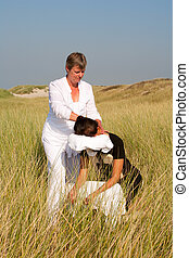 Chair massage in the dunes on the island Ameland, the...