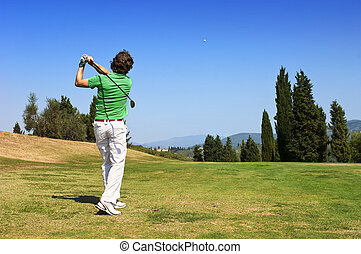 Golf Player hits his ball on the fairway