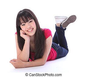 Oriental teenager high school girl lying on floor - Lying on...