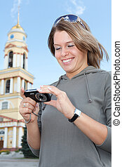 Young woman looking at cam screen - Young beautiful woman...