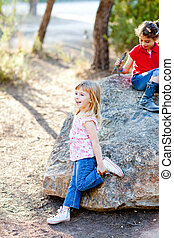 friends kid girls playing in forest rock