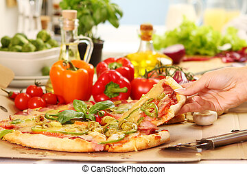 Fresh and tasty pizza on kitchen table