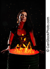 Beautiful woman and iron barrel with fire inside - Sexy...