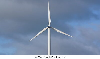 Wind generator with clouds background