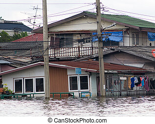 Flooded houses in Bangkok, Thailand - Flooded houses along a...