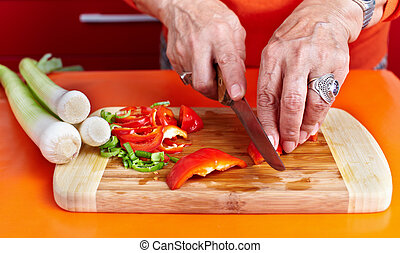 Senior woman's hands cutting vegetables - Senior woman hands...