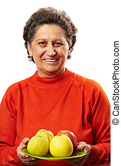 Senior woman with apples