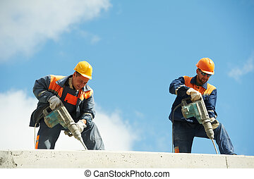 construction workers with perforator - Two Builder workers...