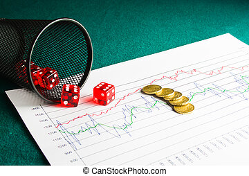 five dice and coins on financial chart