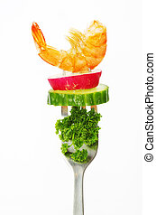 food on a fork isolated on white background
