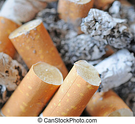 Cigaret ends and ashes, shallow depth of field