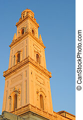 Duomo tower against blue sky in Lecce, Italy