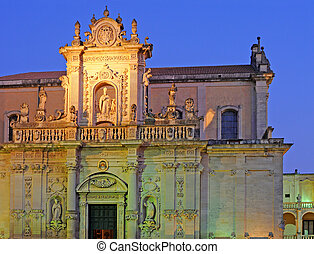 Duomo with artificial lighting at dusk in Lecce, Italy