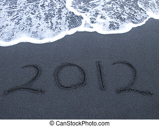 Black Volcanic Sand - 2012 new year written in black...