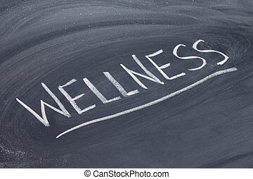 wellness word on blackboard - wellness word in white chalk...