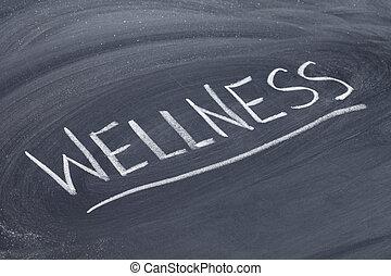 wellness word on blackboard - wellness word in white chalk...