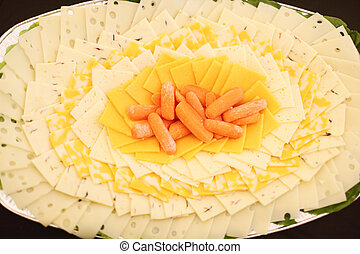 Gourmet cheese tray with carrots.