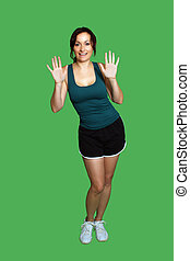 Beautiful Brunette with Fitness Wear Isolated on Green - A...