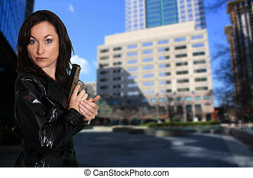 Beautiful Brunette with a Pistol (4) - Close-up of a lovely...