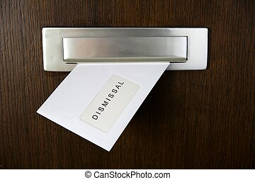 Dismissal - A letter in a letterbox of a door, written...