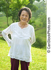 Back pain - 80's Asian senior woman back pain after exercise...