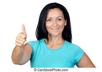Adorable woman with blue t-shirt saying Ok isolated on a...