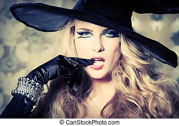 hat magic - Charming halloween witch over vintage...