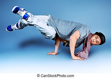 breakdance - Young man dancing hip-hop at studio.