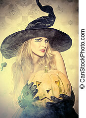 pumpkin - Charming halloween witch over vintage background.