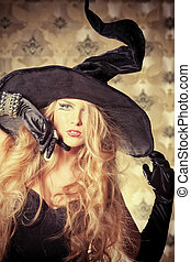 mystery - Charming halloween witch over vintage background.