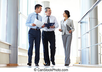 Co-workers talking - Confident business partners walking...