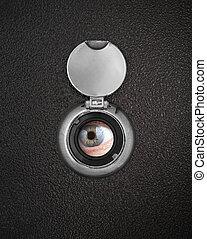 Human eye in peep hole closeup